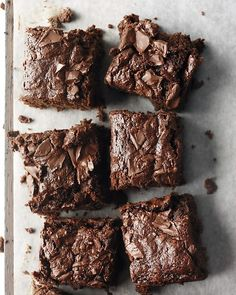 Whole-Wheat Brownies by marthastewart:  These brownies get a healthy boost from whole-wheat flour and applesauce, while cocoa powder plus 8 ounces of semisweet chocolate make them nice and fudgy. #Brownies #Healthy
