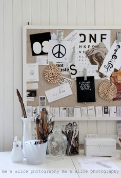 I like how this bulletin board stays within the same color palette. These kinds of things add a lot of interest to a room.