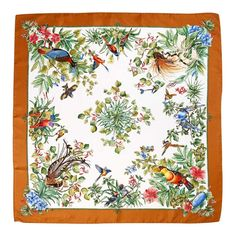 Colourful birds feature on a silk scarf from the Gucci archi