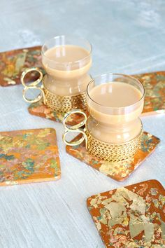 Use variegated gold leaf flakes to create these easy DIY gold leaf coasters. Upcycle vintage teak coasters to create a beautiful hostess gift. Perfect for holiday entertaining!