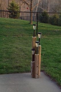 Landscape timbers cut and solar lights put into drilled holes for light solar light post aloadofball Image collections