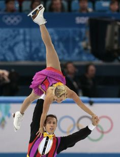 Kirsten Moore-Towers and Dylan Moscovitch of Canada compete in the pairs short program figure skating competition at the Iceberg Skating Palace during the 2014 Winter Olympics, Tuesday, Feb. 11, 2014, in Sochi, Russia.
