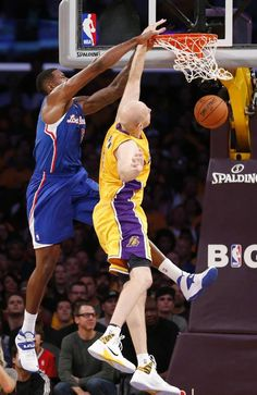 Los Angeles Clippers DeAndre Jordan, left, dunks the ball over Los Angeles Lakers' Chris Kaman