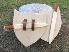 Wood Sword and Wood Shield Handcrafted Toy Set with Genuine Leather Accents READY TO SHIP! Great gift for that knight in training or warrior princess. Handcrafted Solid Wood Sword and Shield Set with genuine leather accents. Wooden Sword Diy, Wooden Diy, Hot Toys Iron Man, Toy Swords, Making Wooden Toys, Bone Crafts, Wooden Projects, Diy Holz, Camping Crafts