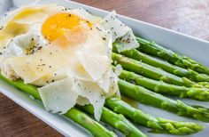 Asparagus topped with shaved Parmesan cheese and fried organic egg ...