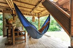 Hammock and bamboo staircase. Dream house in Bali. Off grid eco bamboo house nestled in Bali highlands near volcano. Sustainable house made entirely from bamboo using water wheel to generate electricity.