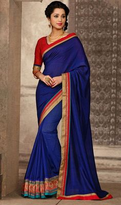 Classic navy blue Manipuri silk sari with contrast blouse makes you center of attraction of everybody's eyes. The sari is ornamented with golden woven lace, sequins, Banarasi inspired border and contrast red border which enhances the look. The sari pairs with contrast red cotton, jacquard stitched blouse as shown in the picture. #NewDesigningCasualSaree