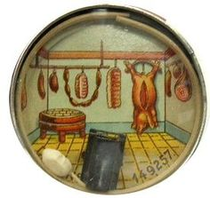 Vintage dexterity puzzle of a mouse in the butcher shop.  One tries to move the white mouse into the trap at the bottom.
