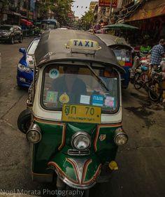 Taking a tuk tuk in Bangkok