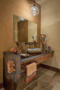 Decoração rústica para pia de banheiro com concreto, madeira e aço.