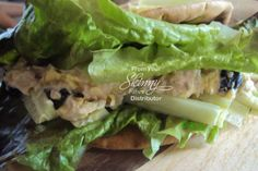 Salmon Salad Pita Bread (Photo by Lorinda Fleming)  Serves: 2  1 5 oz can salmon, in water & drained 6 olives, chopped 1/2 cucumber, sliced length ways in strips 3 Tbsp. Miracle Whip or Mayo 1 Tbsp. Chipotle Ranch salad dressing 4 Red leaf lettuce Onion, sliced 2 Whole Wheat Pita Bread salt & pepper to taste 3 Tbsp. Egg Beaters  Scramble eggs and set aside to cool slightly while you chop other veggies up.  Mix salmon, olives, salad dressing, mayo or Miracle Whip in small bowl.  Place a few…