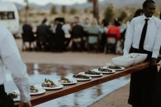Room Forty catering serves up a delicious wedding dinner at Rimrock Ranch. Catering team came out with a long wooden plant with all the meals on them. Each guest got to enjoy being served the wedding meal in a very interactive and fun way. #rimrockranch #bohowedding #desertwedding Big Sur Wedding, Wedding Dinner, Joshua Tree Wedding, Modern Minimalist Wedding, California Wedding Venues, Destination Wedding Planner, Outdoor Wedding Venues, Best Appetizers, Alternative Wedding