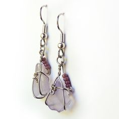 Pretty translucent lavender cultured sea glass wrapped in silver plated jewelry wire and accented with tiny beaded dangles. These OOAK earrings are purposely slightly mismatched giving them a very org