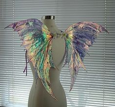 holographic and iridescent wings