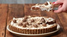 Recipe with video instructions: Chocolatey, malty and oh so tempting. You need this! Ingredients: 450g Maltesers plus extra for decorating, 110g unsalted butter, melted, 100g caster sugar, 4 egg yolks, 200g of dark chocolate, chopped up, 500 ml whole milk, 3 tbsp malt powder, 300ml double cream, 1tsp vanilla extract