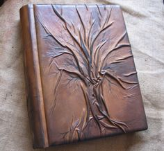 Intrinsic Leather book, beautiful work! DIY: Use Leather and a hot glue gun.. form the tree as you go by pinching the leather/fabric.