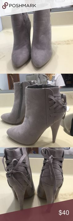 Boots Pair of heal boots size 8 true to size only used once in like new condition no damages and has zippers on size and the bow in the back the color is grey izabella rue Shoes Heeled Boots