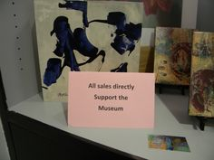 Signage in the museum store. Proceeds from sales help fund the museum.