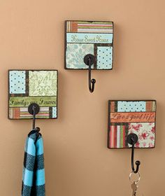 These are on ABC Distributing, but I think these could actually be DIY.  Just use some square shelf board, scrapbook paper, mod podge and some hooks.