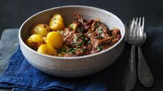 Heavenly slow cooked lamb in a rich madras curry with spicy potatoes. A perfect Saturday night.