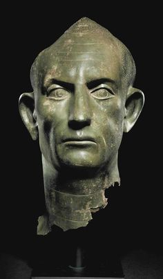 A ROMAN BRONZE PORTRAIT HEAD OF A MAN - CIRCA SECOND QUARTER OF THE 3RD CENTURY A.D.