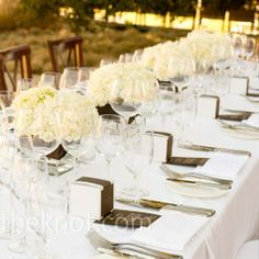 White Reception Decor Work with a natural color palette of ivory, champagne, and brown.  all-white linens for a fresh, clean look.