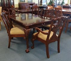 Item # 26382-2 Cherry Stained Dining Room Table w/ 8 Chairs & 2 Leaves - $575