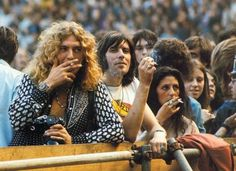 Robert Plant  and then-wife Maureen (smoking) with the crowd....