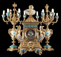 An Impressive Napoleon III Gilt Bronze and Champlevé Enamel Three Piece Clock Garniture designed by Eugene Cornu and made by G. Viot et Cie, Paris. Comprising a clock and a pair of six-light candelabra. c.1865. Offered for sale by Roseberys London www.roseberys.co.uk