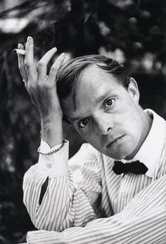 imagine the conversation before someone snapped this photo of Truman Capote