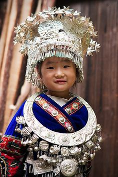 Little Miao girl in traditional costume  | China photo
