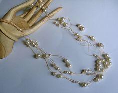 Micro macrame necklace. Multi strand necklace in peaches and cream pearls.. $38.99, via Etsy.