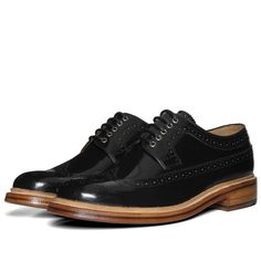 One of Britains most celebrated boot-makers, Grenson have been in the business of producing the finest quality mens footwear since the 19th century. The Sid is a classic long wing brogue that has a slimmer, modern construction when compared to the classic vintage shape.The uppers are made from Grensons premium hi-shine calf leather, metal eyelets and an authentic goodyear welted leather sole.