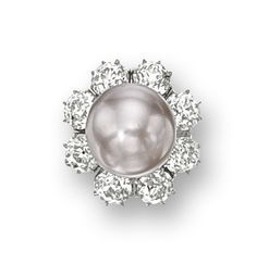 VERY FINE NATURAL PEARL AND DIAMOND RING.  The ring centring on a natural pearl measuring approximately 13.45 x 13.65mm, surrounded by old European-cut diamonds together weighing approximately 7.00 carats; accompanied by an extra diamond-set ring fitting, pearl detachable; mounted in platinum.