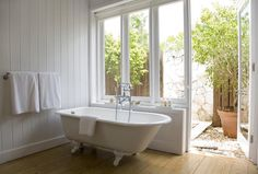 Soothing indoor-outdoor bathroom/clawfoot tub