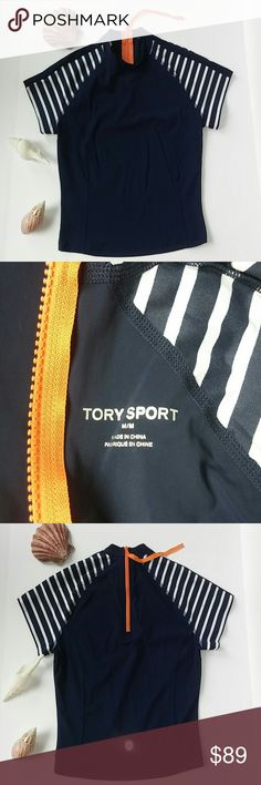 """Tory Burch Sport Rash Guard Swim Suit Top Cropped Condition - pre-owned with no signs of use or wear Brand: Tory Burch Sport Size: M/ 6-8 Color: Dark Blue and White Stripes with Orange Exposed Back Zipper Type: Cropped Rash Guard Short Sleeves Pull On Styling 3/4 Back Zipper with Extended Puller in Contrast Fabric Reflective Back Logo Cover-up UPF 50 Nylon Blend Hand Wash  Measurements 34"""" Underarm to Underarm - doubled 18-1/2"""" Total Length from back collar to bottom hem Tory Burch Swim"""