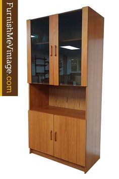 Vintage Danish teak bookcase with lighted display area at top. Notable design details include smoked glass panels accented with teak trim. Open the cabinet doors to reveal a spacious china cabinet. Cabinet Doors, Tall Cabinet Storage, Modern Bookcase, Mid Century Modern Furniture, Glass Panels, Danish, Teak, Mid-century Modern, Study Desk