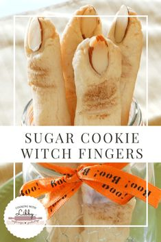 These Witch Fingers are made with sugar cookie dough and is the perfect creepy Halloween recipe to make for your guests. With almonds used for fingernails and chocolate chips used as moles, they make the perfect party food for your Halloween get together! #halloween #chocolate #halloweenparty #chocolate #creepy #halloweenfood