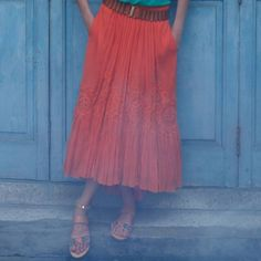 Anthropologie sonah gauze skirt Orange maxi skirt with a higher hem in the front. Full long skirt adorned with lace. Featuring hidden pockets. Anthropologie Skirts