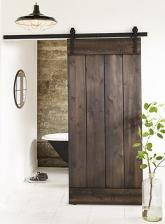 Our Pitch Black Rustic Alder Plank Door Kit lets you bring a beautiful sliding barn door inside. These real barn door kits reclaim spaces across all genres of design, from contemporary to traditional. Barn Door Track, Diy Barn Door, Sliding Barn Door Hardware, Sliding Doors, The Doors, Wood Doors, Entry Doors, Panel Doors, Front Entry