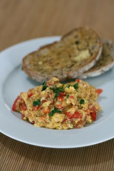 Perico Venezolano (Venezuela): scrambled eggs with onions and tomatoes served as breakfast wth arepa or bread