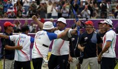Italy's team celebrate their win over the U.S. during the men's archery team gold medal match at the Lords Cricket Ground during the London 2012 Olympics Games July 28, 2012. REUTERS/Suhaib Salem (BRITAIN - Tags: SPORT OLYMPICS SPORT ARCHERY)