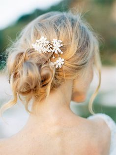 This charming hair comb features hand-painted enamel flowers scattered along rhinestone-studded branches. With a swirling design, it's perfect for accenting buns or adding a bit of sparkle to Juliet cap veils. | Photo by Thecablook Fotolab