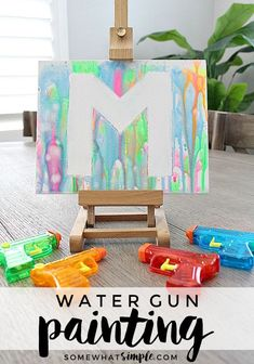 Water Gun Painting If youre looking for some fun inexpensive art projects for kids this summer add painting with water guns to your list Somewhat Simple Summer Art Projects, Summer Crafts For Kids, Summer Activities For Kids, Art Projects For Adults, Toddler Art Projects, Easy Art Projects, Family Art Projects, Summer Fun For Kids, Art Activities For Kindergarten