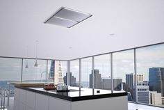 Do you want a cooktop in your kitchen island but hate the look of a bulky hood? Check out this new hood from #zephyr that mounts discreetly into the ceiling above. #dreamkitchen #contemporarykitchen