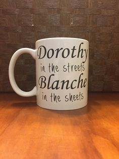 For all you Golden girls fans out there. This listing is for a white 12 ounce mug with black typography reading Dorothy in the streets Blanche in