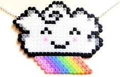 Cute rainbow cloud necklace made with mini beads. Sprite measures 7 x 5.8 cm Silver plated necklace length 50 cm (20 inches) Rainbow cloud is available also as a keychain or magnet. IMPORTANT NOTE: If you want to buy TWO or more of my products, please send me a message and I will
