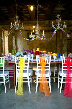 Touches of b right colour with chair sashes.  Lindsay Docherty Photography