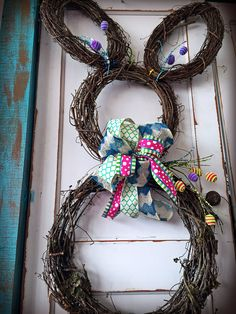 Bunny wreath- ADORABLE door hanger! Made by Robin at TMI Gifts out of 2 round grapevine wreaths, 2 oval wreaths, a bow, & a couple easter sprays! Be watching for the how to video to create your very own Peter Cotton Tail!  www.tmigifts.com