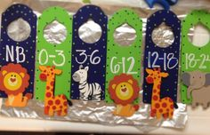 Baby boy, safari nursery closet dividers. Brayden Henry 2013. Simply paint wooden door signs from the craft store, write on with a paint pen, an hot glue a pre-made wooden animal. Finish with a ribbon to hang on the closet rod.